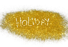 Word Holiday on golden glitter sparkles on white Stock Photos