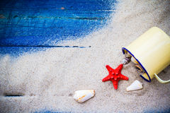 Word holiday laid sand blue board Royalty Free Stock Images