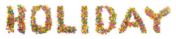 Word holiday made of confetti royalty free stock photo