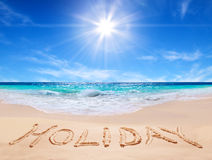 Word holiday on the tropical beach Royalty Free Stock Image