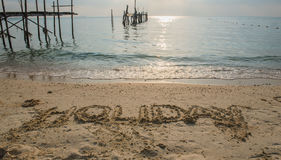 """Word """" HOLIDAY """" Write in sand on the beach Stock Photography"""