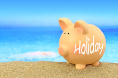 Word Holiday written on piggy bank Stock Photography
