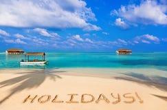 Word Holidays on beach Stock Photos