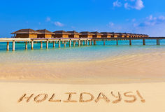 Word Holidays on beach Royalty Free Stock Image