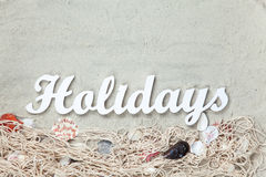 Word Holidays and net with shells Royalty Free Stock Images