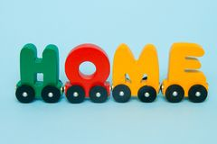 Word Home made of letters train cars alphabet. Bright colors of red yellow green and blue on a white background. Early childhood e royalty free stock image