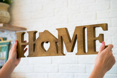 The word HOME made of wooden letter Stock Photos