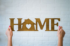 The word HOME made of wooden letter Royalty Free Stock Photos