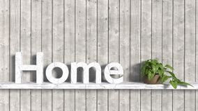 The word home in old wooden letters on a shelf attached to a pla Stock Image
