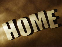 The word Home on paper background Stock Photos