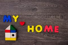 Word Home from wooden letters stock photo