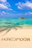Word Honeymoon on beach Royalty Free Stock Images