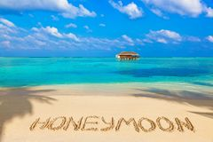 Word Honeymoon on beach. Concept holiday background Royalty Free Stock Photography
