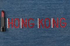 Word Hong Kong, made of rhinestones, encrusted on denim. World Fashion. Royalty Free Stock Photo