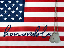 Word honorable and dog tags on flag. Military dog tags and word honorable on American flag background Royalty Free Stock Images