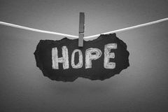 Word Hope on black piece of paper Royalty Free Stock Photography