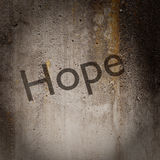 Word 'Hope' on grunge wall Stock Image