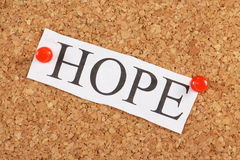 The word Hope. Typed out in capital letters on crumpled white paper and pinned to a cork notice board Royalty Free Stock Photography