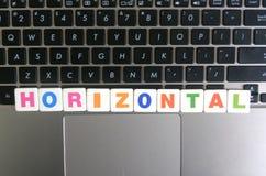 Word Horizontaal op toetsenbordachtergrond Stock Fotografie