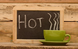 Word hot on chalkboard Stock Images