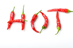 Word Hot From Red Spicy Chili Peppers Over White Stock Photo