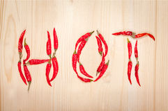 Word hot made of chili peppers Stock Images