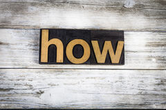 How Letterpress Word on Wooden Background. The word `how` written in wooden letterpress type on a white washed old wooden boards background royalty free stock images