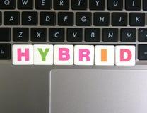 Word Hybride op toetsenbordachtergrond Royalty-vrije Stock Afbeeldingen