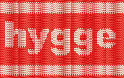 Word HYGGE on knitting texture Stock Photo