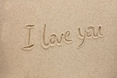 The word i love you written on the sand Stock Photography