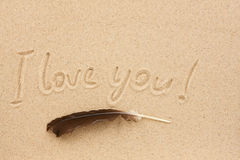The word i love you written on the sand Royalty Free Stock Photos