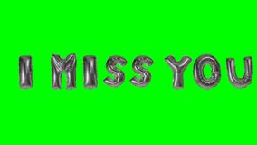 Word I miss you from helium silver balloon letters floating on green screen -. Word I miss you from helium silver balloon letters floating on green screen stock video footage