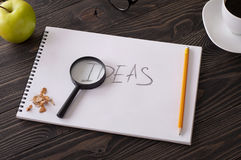 Word idea written in pencil in a notebook Royalty Free Stock Image