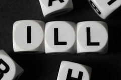 Word ill on toy cubes Stock Images