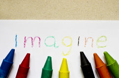 The word IMAGINE written on paper. Stock Photography