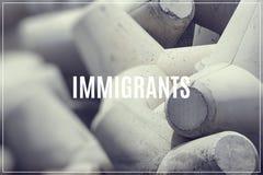 Word Immigrants over breakwater concrete block. Word Immigrants over breakwater concrete block Royalty Free Stock Photos