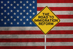 Word of immigration reform with USA flag Stock Photos