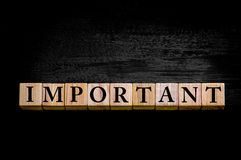 Word IMPORTANT isolated on black background Stock Images