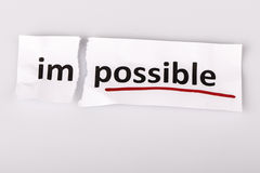 The word impossible changed to possible on torn paper Stock Photos
