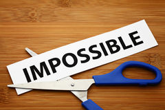 Word impossible cut to possible Royalty Free Stock Photos