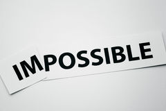 Word impossible cutted to be possible Royalty Free Stock Photography