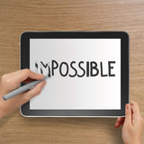 Word impossible to possible with stylus eraser Royalty Free Stock Photography