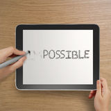 Word impossible to possible with stylus eraser Stock Photo