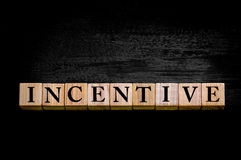 Word INCENTIVE isolated on black background Royalty Free Stock Photos