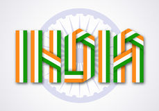 Word India made of interlaced ribbons with Indian flag colors. Stock Image