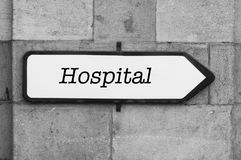 Word on indication panel on stoned wall - Hospital. Concept word on indication panel on stoned wall - Hospital Royalty Free Stock Photos