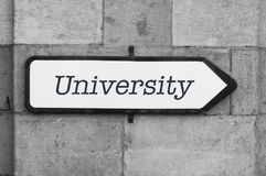 Word on indication panel on stoned wall - University. Concept word on indication panel on stoned wall - University Stock Image