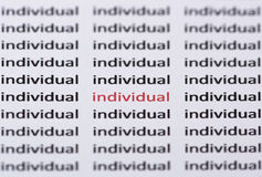 The word individual highlighted in red with shallow focus. The word individual highlighted in red & with shallow focus amongst similar black text Royalty Free Stock Images