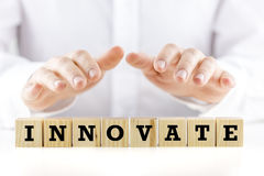 The word - Innovate - on wooden blocks Royalty Free Stock Photos