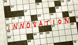 The Word INNOVATION on Crossword Puzzle Stock Images